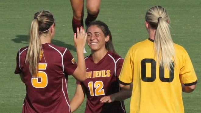 Alyssa Martinez (12) is all smiles over being healthy enough to be a starting defender this season for ASU soccer.