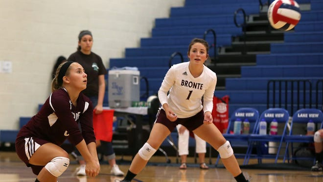 Bronte's Emily Davidson hits the ball as Kacelyn Follis backs her up during the Lady Longhorns' game against the Sweetwater Lady Mustangs at the 2016 Nita Vannoy Memorial Volleyball Tournament  08.19.16