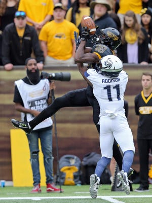 Nov 21, 2015; Hattiesburg, MS, USA; Southern Miss Golden Eagles wide receiver Michael Thomas (88) has a catch broken up by Old Dominion Monarchs defensive back Brandon Addison (11) in the first quarter at M.M. Roberts Stadium.
