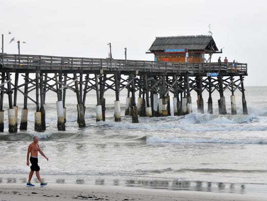 With the exception of all the live tv trucks and a few more surfers than normal,  it looked like any other day at the Cocoa Beach Pier with Tropical Storm Arthur off the coast.