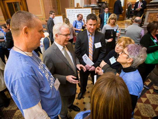 """Rep. John Forbes (D) speaks with school board members from around the state at the Iowa Statehouse Tuesday, Jan. 30, 2018, in Des Moines, Iowa. The Iowa Association of School Boards & """"Parents for Great Iowa Schools"""" were at the capitol advocating for public education."""