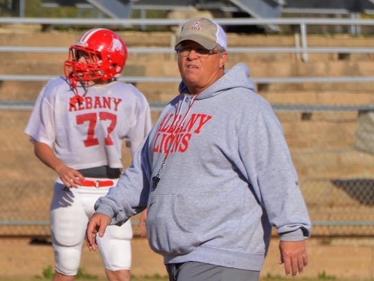 Albany coach Denney Faith runs practice in November 2017. Faith has recorded 290 victories as the Lions head coach, and could become the 12th Texas coach to top 300 wins this season.