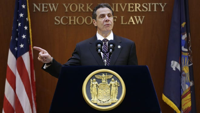 Gov. Andrew Cuomo speaks at New York University on Monday, outlining his reform agenda. The governor said he won't sign a budget for the state this year that doesn't include an ethics plan for legislators.