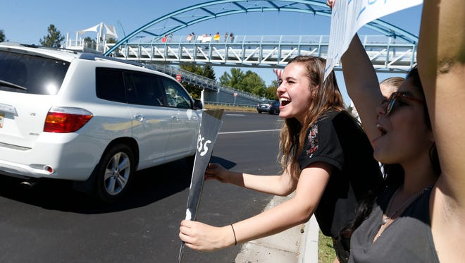 Megan Bartlett of Dakota Ridge High School, center, participates in a protest against a Jefferson County School Board proposal to emphasize patriotism and downplay civil unrest in the teaching of U.S. history, in the Denver suburb of Littleton on Thursday, Sept. 25, 2014. Several hundred students walked out of class Thursday in the fourth straight day of protests in Jefferson County.