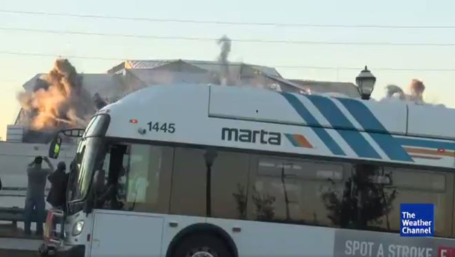 City bus blocks Weather Channel live shot of Georgia Dome implosion.