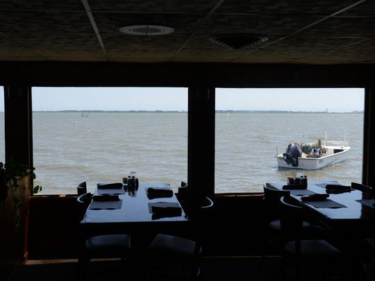 A boat is tied up just outside Wright's Family Restaurant in Atlantic, Va. on Thursday, Aug. 25, 2016. After 45 years in business the popular waterside seafood restaurant is closing Oct. 2nd.