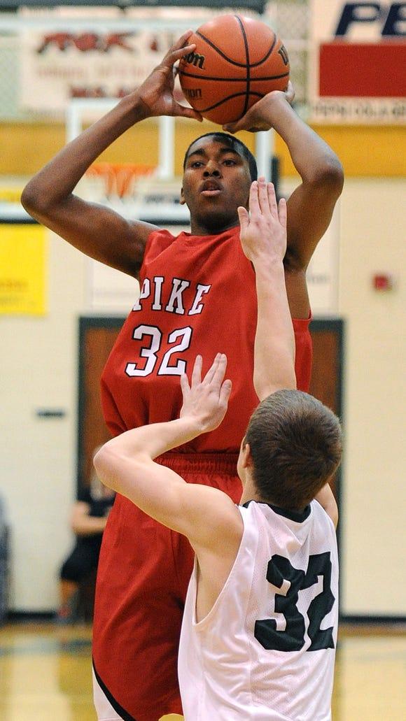 Pike's Tahjai Teague takes a jump shot against Pendleton Heights, Thursday, January 2, 2014, in Pendleton.