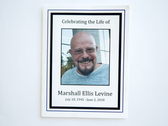 A view of the funeral program for Marshall Ellis Levine,
