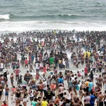A general view shows New Year party revellers and holidaymakers gather on the North Pier Beach during New Year festivities in Durban on January 1, 2016.