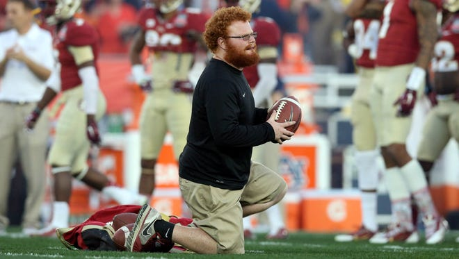 Jan 6, 2014; Pasadena, CA, USA; Florida State Seminoles bellboy Frankie Grizzle-Malgrat during warm-ups prior to facing the Auburn Tigers in the 2014 BCS National Championship game at the Rose Bowl.  Mandatory Credit: Matthew Emmons-USA TODAY Sports