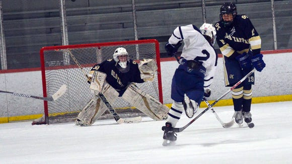 Zach Matesic (2) of Paramus/Lyndhurst/Hackensack takes a shot as Northern Valley goalie Jack Fitzgerald (30) minds the net in a Jan. 08, 2017 Big North hockey game.
