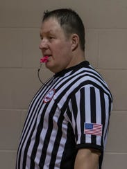 Todd Gooding used a pink whistle during the Marshall-Harper