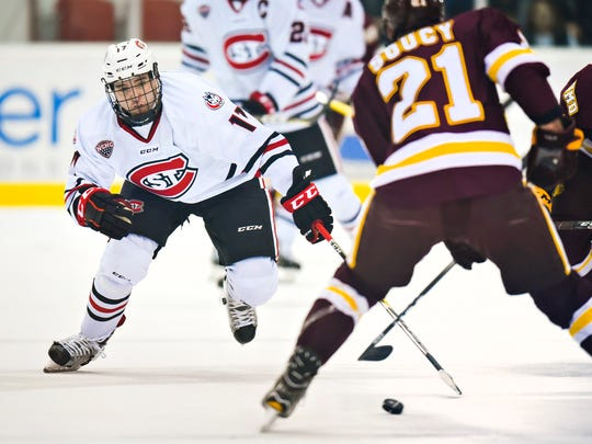 St. Cloud State's Jacob Benson tries to block a pass by University of Minnesota-Duluth's Carson Soucy during the first period Saturday, Nov. 5, at the Herb Brooks National Hockey Center.
