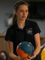 West Morris senior Paige Piombino of bowls in the Morris