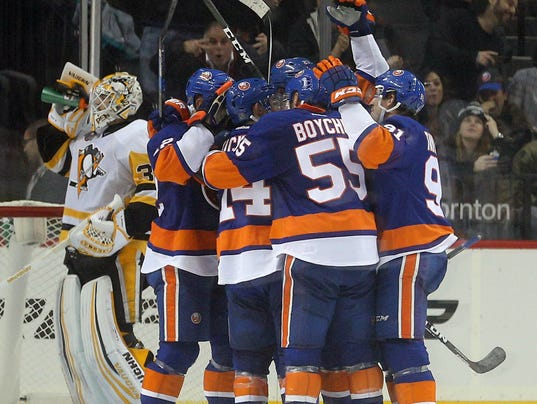 USP NHL: PITTSBURGH PENGUINS AT NEW YORK ISLANDERS S HKN USA NY
