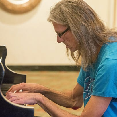 John Christopher Jones plays piano at the Omni Severin