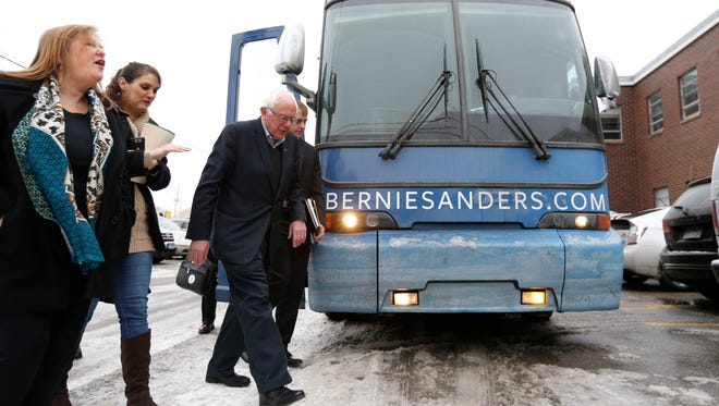 Democratic presidential candidate Bernie Sanders walks into his campaign offices Tuesday, Jan 26, 2016 on Merle Hay Road in Des Moines.