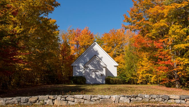 Fall foliage surrounds the Randolph Church in Gorham, N.H., on Oct. 11, 2016.