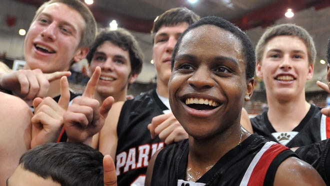 "Kevin ""Yogi"" Ferrell poses with his  Park Tudor team that was down by 9 in the third quarter and came back to win the semi-state over Providence. Park Tudor defeated Providence 62-49 in the 2A semi-state at Southport Saturday March 17, 2012. Rob Goebel/The Star"