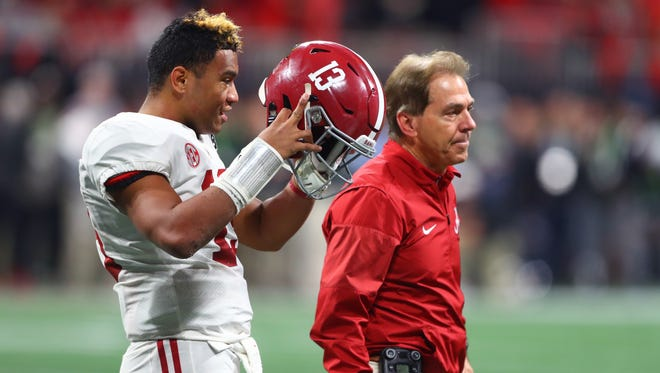 This file photo from Jan 8, 2018 shows Alabama quarterback Tua Tagovailoa, left, and coach Nick Saban during the CFP national championship game against Georgia at Mercedes-Benz Stadium in Atlanta.