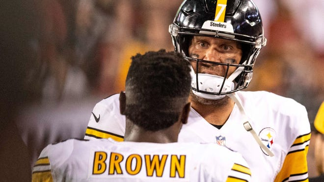 Sep 24, 2018; Tampa, FL, USA; Pittsburgh Steelers quarterback Ben Roethlisberger (7) and wide receiver Antonio Brown (84) talk on the sideline during the first half against the Tampa Bay Buccaneers at Raymond James Stadium. Mandatory Credit: Douglas DeFelice-USA TODAY Sports