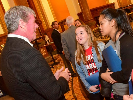 State Sen. Brad Zaun talks with East High School seniors