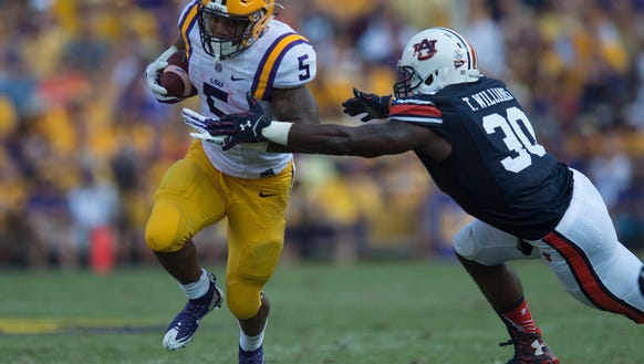 Louisiana State running back Derrius Guice (5) is tackled