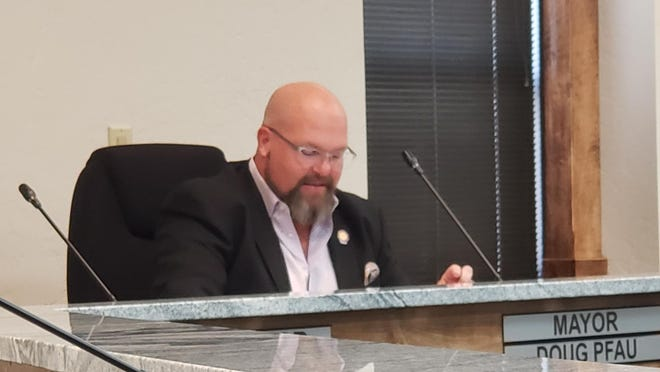 Ardmore Mayor Doug Pfau reads a proclamation condemning racism during a special meeting of the City Commission Friday afternoon.