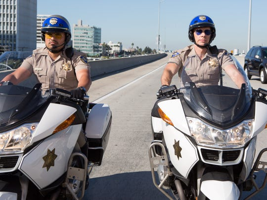 Michael Peña, left, and Dax Shepard ride the roads