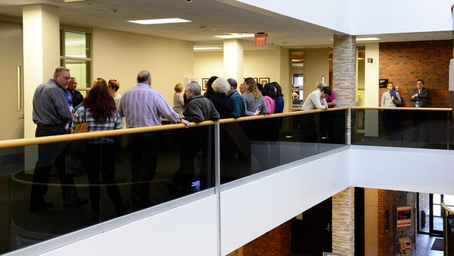 The public waits outside while Terra State Community College board members discuss legal issues in executive session.