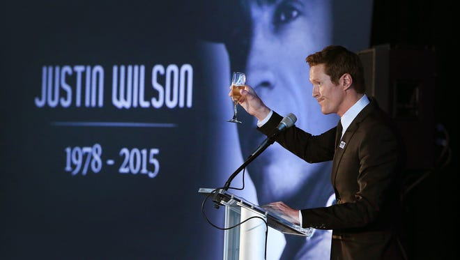 IndyCar champion Scott Dixon led the toast to Justin Wilson during Tuesday's Celebration of Life at Indianapolis Motor Speedway