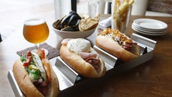 A photo of the Chicago hot dog, Croque Madame hot dog,