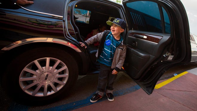 6-year-old Jason Patterson, who suffers from congenital heart disease, exits a limousine outside Chuck E. Cheese's at Mesilla Valley Mall, March 31, 2016. The donated limo ride and party at Cheese's was a prelude to Patterson and his family's trip to Disneyworld organized and paid for by the Make-A-Wish Foundation.