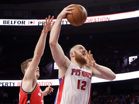 Pistons center Aron Baynes shoots while defended by Raptors center Jakob Poeltl during the first half April 5, 2017 at the Palace.