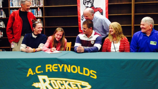 Reynolds senior Anna Vess has signed to run college cross country and track for N.C. State.