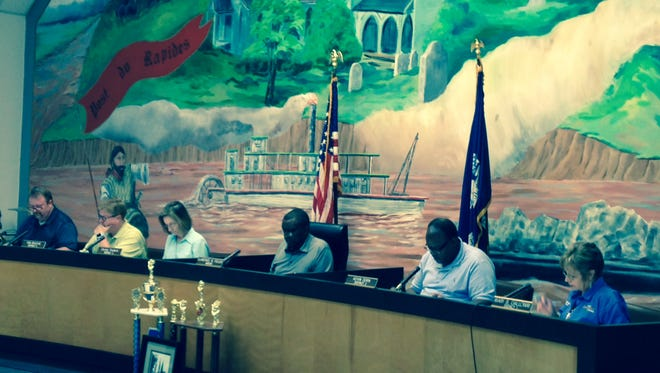 Pineville Mayor Clarence Fields (center) and members of the Pineville City Council look over budget figures Thursday afternoon during a public hearing on the amended 2015-16 budget and the 2016-17 budget. Ordinances approving both were unanimously adopted. From left are Nathan Martin, Tom Bouchie, Christy Frederic, Fields, Kevin Dorn and Mary Galloway.