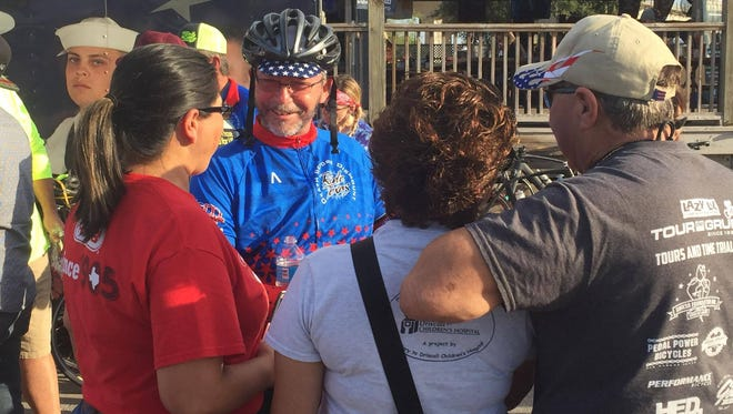 Johnny Wartell greets friends and family after finishing his 575 mile bike ride from Wichita Falls to Corpus Christi.