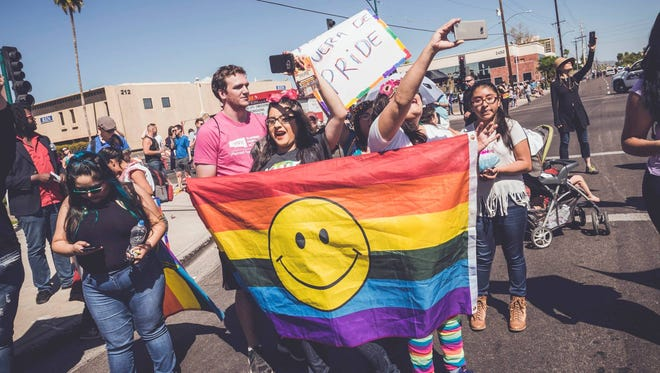 Members of Trans Queer Pueblo and their supporters march in the Phoenix Pride Parade on April 2, 2017. The group, which advocates for the rights of LGBT undocumented immigrants, said it wanted to temporarily disrupt the parade because it feels Phoenix Pride needs to ensure that the principles it espouses apply to everyone in Arizona's diverse LGBT communities.