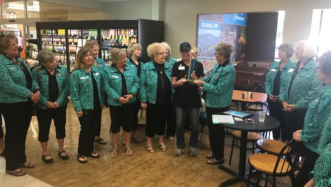 The Ruidoso Valley Greeters, a committee of the Ruidoso Valley Chamber of Commerce, presented the Champion of Service Award to Michelle Favre of Albertsons. Favre was nominated for her superior customer service and her willingness to help her fellow employees as well as Albertsons' customers.