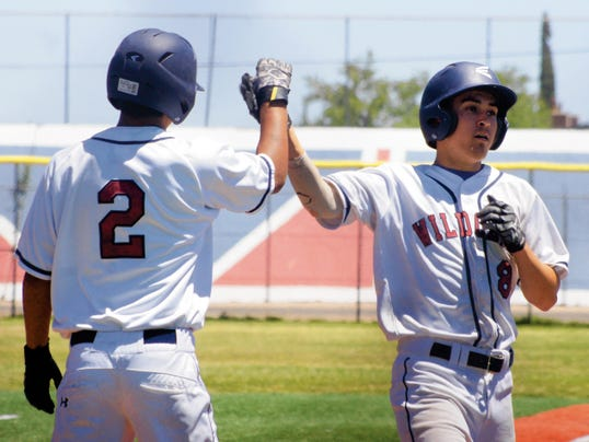 Headlight File Photo   Wildcat players Shane Mora (2) and Dominic Miranda (8) have been the M & M Boys at the bottom half of the Deming High batting order. These two Cats have extended Wildcat inniongs all season long with active bats.