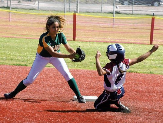 Bill Armendariz - Headlight Photo   Lady Cat Monique Jimenez (8) slides into second base, ahead of the tag, for a stolen base on Saturday against Mayfield. Jimenez was an offensive weapon, going 3-for-4 on the day with a run scored.
