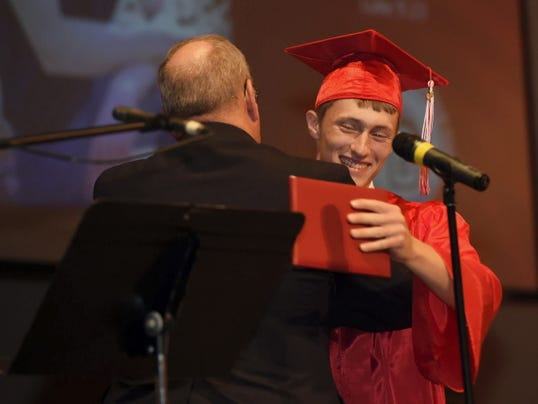Pastor Carl McKee congratulates Aaron McBeth after McBeth received his diploma at the Cumberland Valley Christian School commencement Friday.