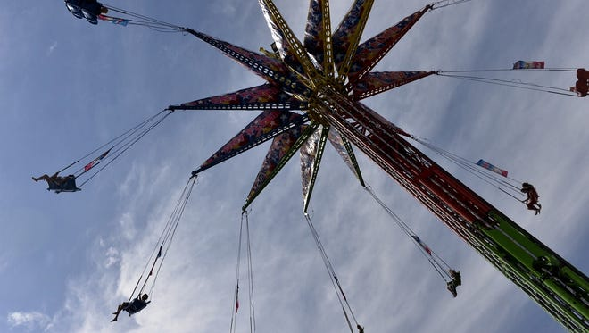 Fairgoers ride the chair swings high into the sky Thursday, Aug. 25, during the opening day of the Minnesota State Fair.