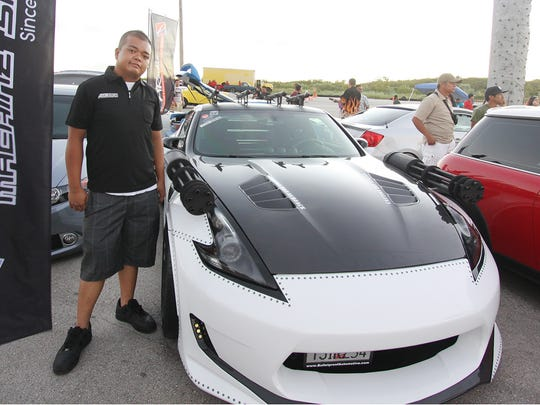 Offset Kings Guam 2014. Best in Show category is  John De Vera with his 2009 370z with built in rail guns and rockets on the roof.