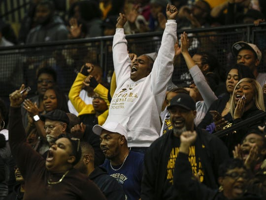 A Arlington Golden Knights fan reacts during the game against the Broad Ripple Rockets at Arlington High School on Friday, Feb. 9, 2018.