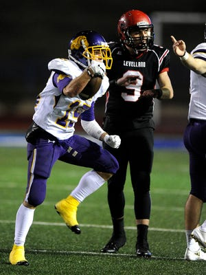Wylie cornerback Gatlin Martin (15) celebrates after an interception during the first quarter of the Bulldogs' 49-14 win in the Class 4A Div I state quarterfinal playoff game on Friday, Dec. 2, 2016 at San Angelo Stadium.