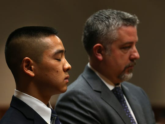 Charles Tan listens to ADA William Gargan recount testimony like Tan's mothers statements to the the 911 operators.