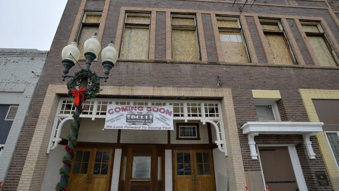 Although boarded over now, the second-floor windows of the Belt Theater are in the process of being restored as part of the building's renovation.