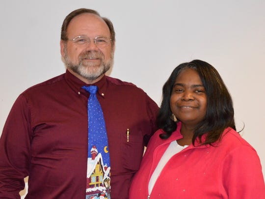 Employee receiving a 25-year service award was Erica Pickens, at right; and Dan Pressley received a 30-year service award, at left.