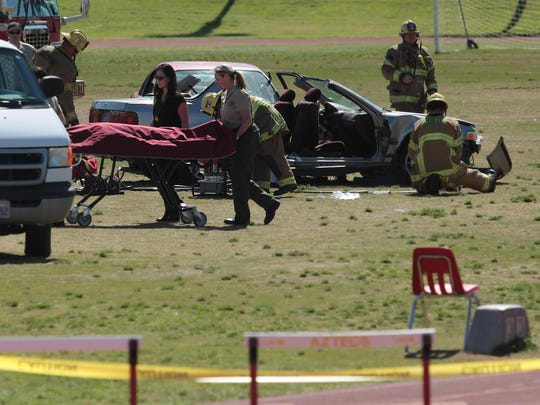 During the filming, a student actor was covered and taken away from the scene.